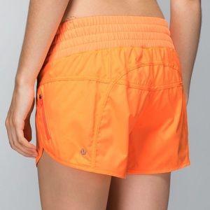 LULULEMON orange Tracker Shorts 4